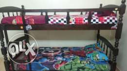 Bunk bed with mattress. .29 inches flat tv