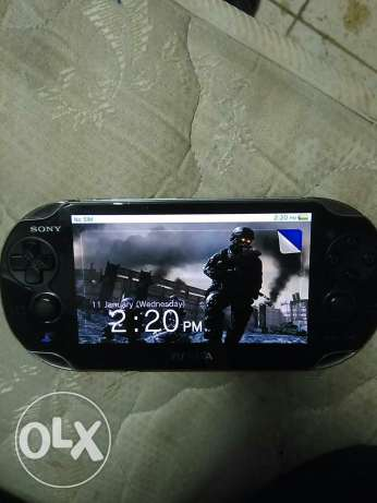 Ps vita with 8 game card and 4gb memory caed