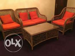4 seater sofa set with a table