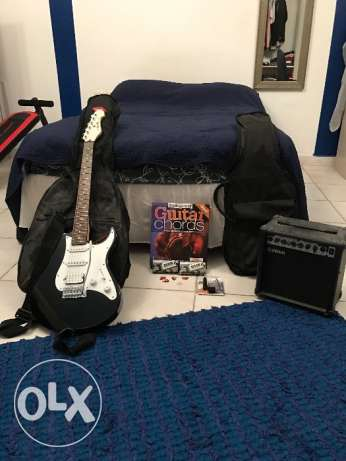 Electric Guitar, Amplifier, Chords Book, Picks, Tuners, and Travel Bag