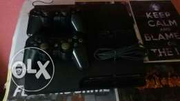 PlayStation 3 (320 gb) with 2 controllers And ANY 2 Games you want !!