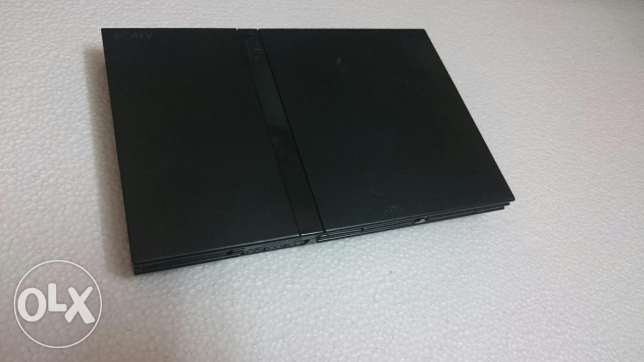 Playstation 2 food condition with 26 cd games