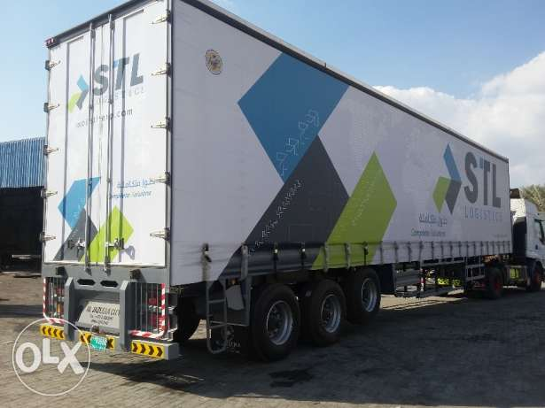 Brand new curtain side trailer with air suspension tyre and rim.