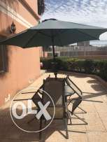 Outdoor table and chairs and umbrella