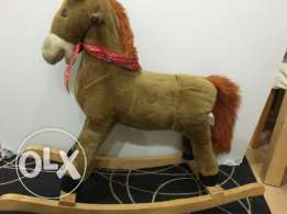 swinging horse toy