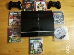 PlayStation3 (40gb) with 7 Games including Minecraft and 2 Controllers