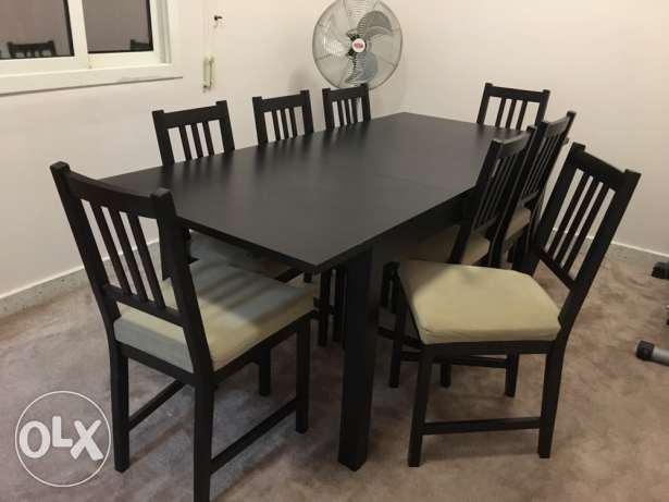 extendable IKEA dining table with 8 chairs
