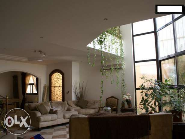Beautiful villa with a large pool and all day natural light for Rent