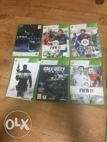 Xbox 360 with 10 games CDs. الدمام -  2