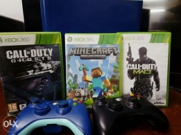 Xbox 360 w/ 2 controllers and 3 games