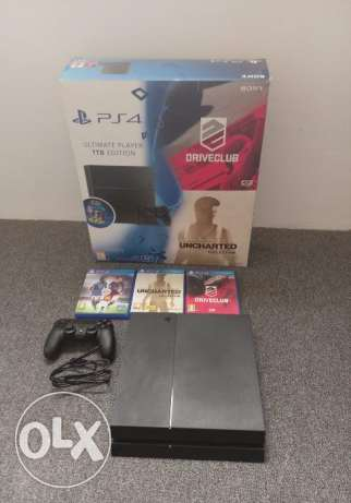 Almost New PS4 1 TB for sale with games