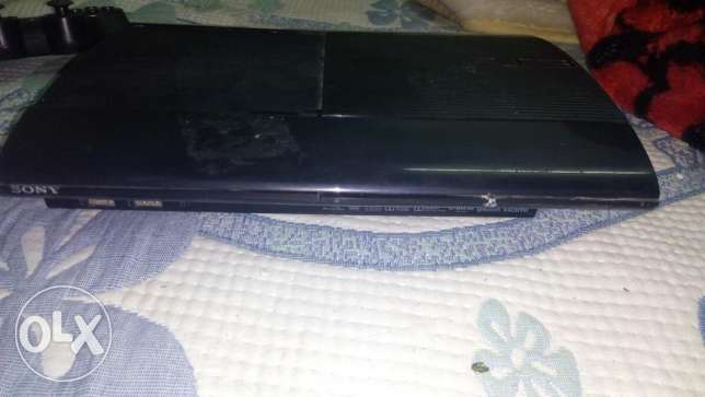 PS3 super slim used 2 yearبلاى استيشن ٣ سوبر سليم بحاله جيده ه