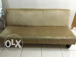 Sofa bed in beige color
