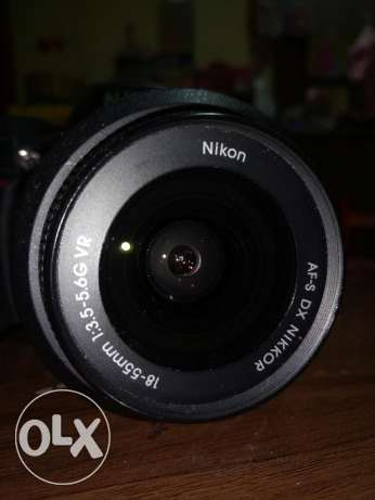 nikon D3100 black with body, lens, charger, and 16GB SD CARD