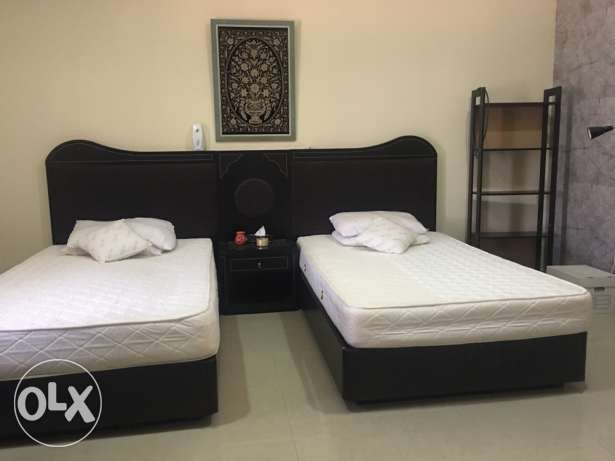 Twin bed room, mattress, wheelchair and big tv screen.