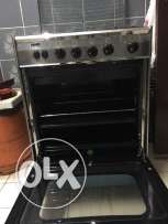 Urjent sale Refrigerator and  4 burner oven only six month used .