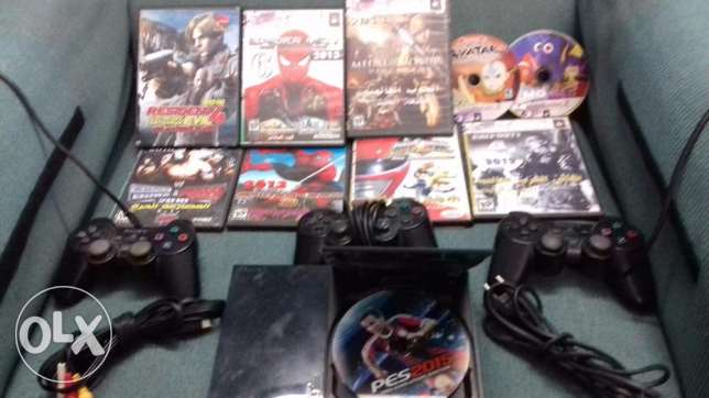 Play station 2 with cd's and 3 remotes