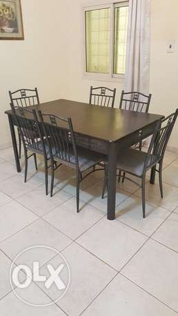 DINNING TABLE - ALMOST NEW - 6 Seater with Brown Table Wooden TOP