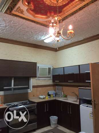 A furnished flat for rent in Al Nahdah district