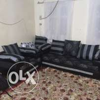 Black sofa set good condition 4 seater and one table
