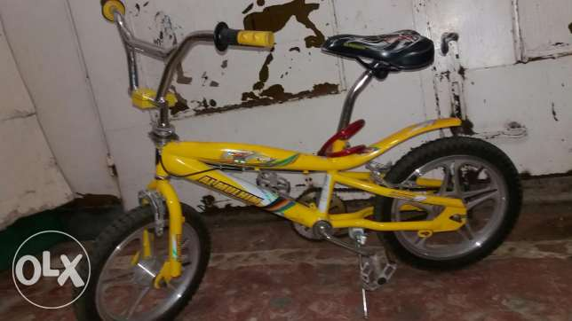 Yellow Cobra Cycle with cycle Lock