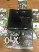 Xbox 360 with 10 games CDs.