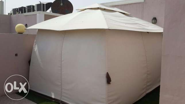 Outdoor tent with grass