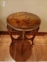 Decorative table with decorative brass and glass top