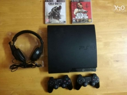 PlayStation 3 Slim (160 gb) + 2 Controllers and 2 Games and Headsets