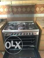 Ariston Cooker 90X60 4Gas+2 Electric plates Stainless Steel With Grill