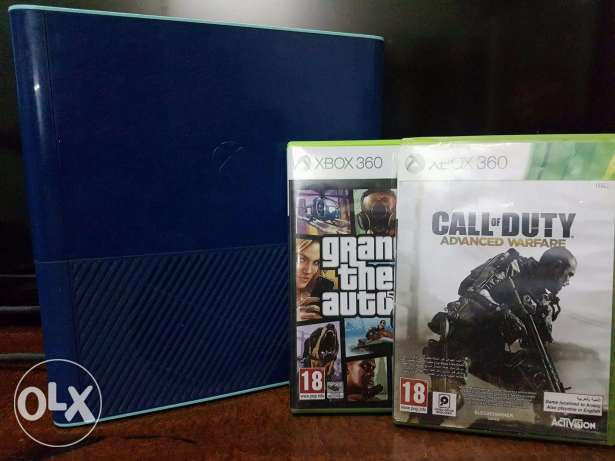 Xbox 360 w/ 2 controllers and 2 games