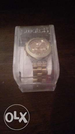 Swatch watch, gold color