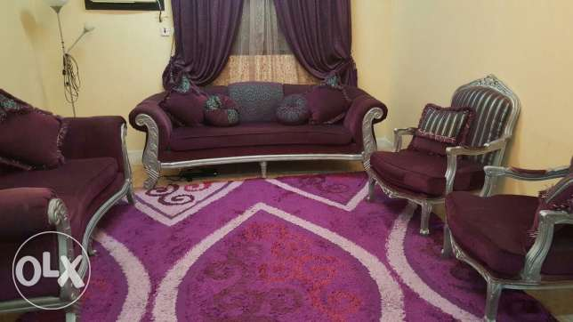 Sofa set with a curtain and a Turkish rug
