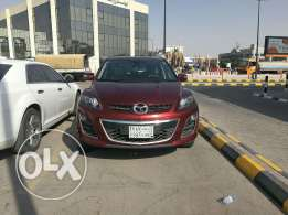 Mazda CX-7 2011for lease transfer or cash 35000 sar .