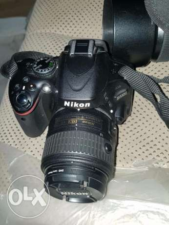 Nikon D5100 DSLR with extra zoom lens. (for urgent sale)