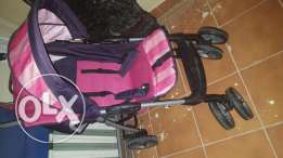 2 strollers with a kangaroo holder